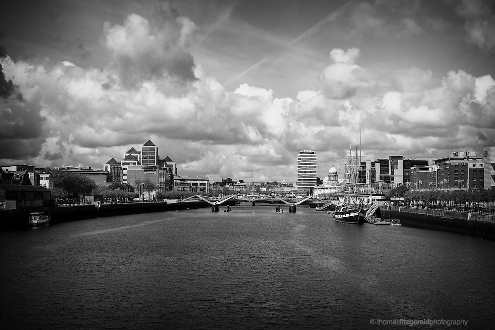 Ominous Clouds gather over Dublin City as seen from the Samuell Beckett Bridge, in black and white