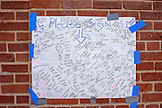 Baltimore, Maryland - April 21, 2015: Six candles and a poster of signatures memorialize the spot in the West Baltimore neighborhood where Freddie Gray was detained by police. He later died from injuries sustained while in police custody.<br /> <br /> CREDIT: Matt Roth for The New York Times<br /> Assignment ID: 30173645A