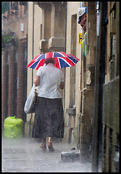 A sudden downpour in Oxford this afternoon caused umbrellas to be unfurled for the first time in weeks, Wednesday May 30. Photo By Mark Chappell/i-Images.© Mark Chappell/i-Images 2012.