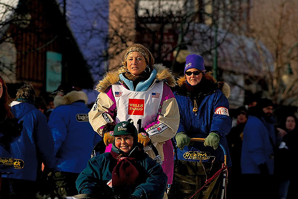 04 March 2006: Anchorage, Alaska - Fan favorite and cancer survivor, DeeDee Jonrowe of Willow, AK heads out during the Ceremonial Start in downtown Anchorage of the 2006 Iditarod Sled Dog Race.