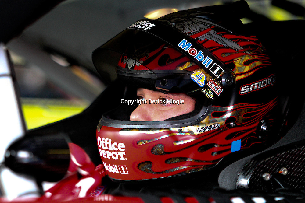 April 15, 2011; Talladega, AL, USA; NASCAR Sprint Cup Series driver Tony Stewart (14) in his car in the garage before practice for the Aarons 499 at Talladega Superspeedway.   Mandatory Credit: Derick E. Hingle