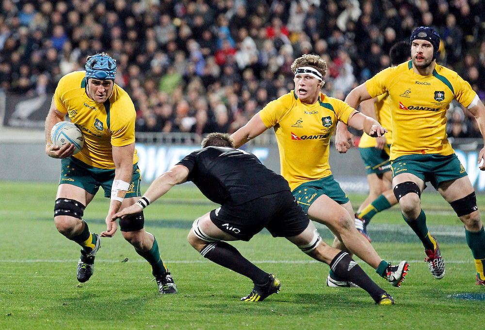 Australias' James Horwell, left, sidesteps New Zealand's Richie McCaw in the 2013 Rugby Championship Bledisloe Cup match at Westpac Stadium, Wellington, New Zealand, Saturday, August 24, 2013. Credit:SNPA / John Cowpland