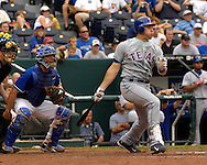 July 29, 2007 - Kansas City, MO..Texas Rangers first basemen Mark Teixeira singles to right field in the ninth  inning against the City Royals at Kauffman Stadium in Kansas City, Missouri on July 29, 2007...MLB:  The Royals defeated the Rangers 10-0.  .Photo by Peter G. Aiken/Cal Sport Media