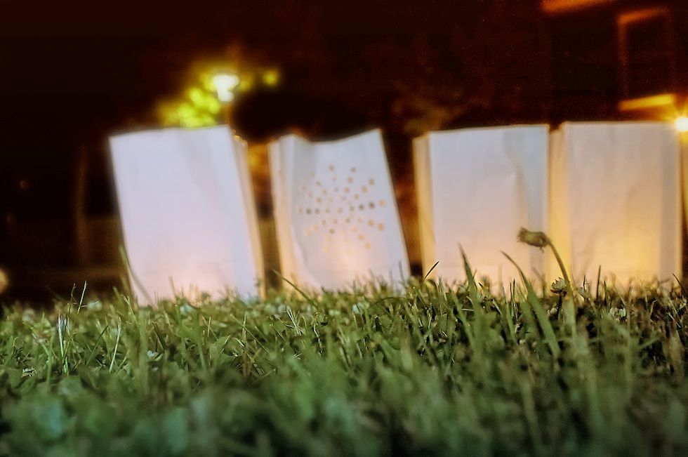 Photographer's Note: There are literally hundreds of luminaries around the circumference of the track surrounded by healthy green grass, which in its own right represents life and the earth.