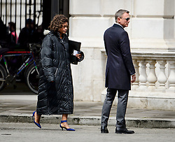 "© Licensed to London News Pictures. 30/05/2015. London, UK. . Filming for the new James Bond film ""Spector"" with Daniel Craig (right) and Naomie Harris (left) at the courtyard of the UK Government Treasury building in Westminster, London . Photo credit: Ben Cawthra/LNP"