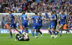 AFC Wimbledon celebrate winning promotion to League One as Graham Carey of Plymouth Argyle lies on the floor dejected - Mandatory by-line: Robbie Stephenson/JMP - 30/05/2016 - FOOTBALL - Wembley Stadium - London, England - AFC Wimbledon v Plymouth Argyle - Sky Bet League Two Play-off Final
