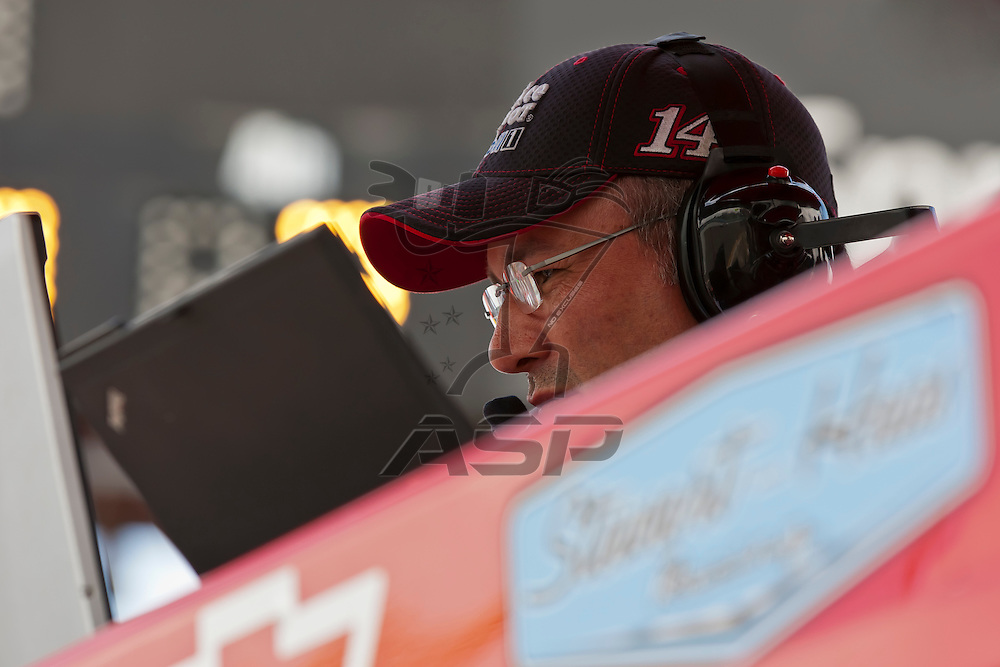 WATKINS GLEN, NY - AUG 12, 2012:  Crew Chief, Steve Addington, watches the computers during the Finger Lakes 355 at The Glen in Watkins Glen International, NY.