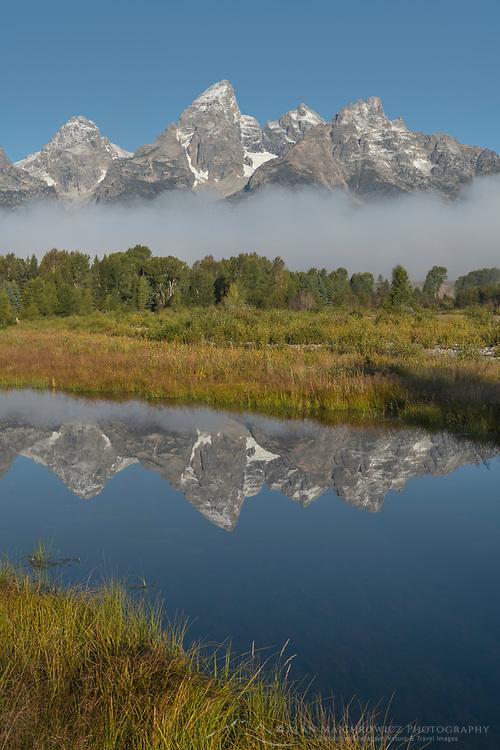 Teton Range reflected in still waters of the Snake River at Schwabacher Landing, Grand Teton National Park Wyoming