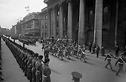 The Annual Commemorative Easter Army Parade.  General view of the Parade passing the reviewing stand with the President Eamon de Valera taking the salute. In the foreground is the Southern Command Pipe Band..18.04.1965