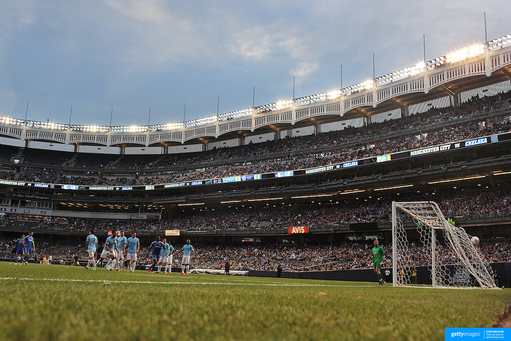 Manchester City goalkeeper Richard Wright can only watch as a Juan Mata free kick hits the back of the net for a goal for Chelsea during the Manchester City V Chelsea friendly exhibition match at Yankee Stadium, The Bronx, New York. Manchester City won the match 5-3. New York. USA. 25th May 2012. Photo Tim Clayton