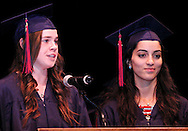 Daisy Brown and Arianna Yanes speak during the Miami Valley School 39th annual commencement at the Victoria Theatre in downtown Dayton, June 7, 2012.
