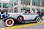 This Pierce-Arrow luxury convertible, with two Easter Rabbits in back seat, is the lead car in the 58th Annual Easter Sunday Vintage Car Parade and Show sponsored by the Garden City Chamber of Commerce. Hundreds of authentic old motorcars, 1898-1988, including antiques, classic, and special interest participated in the parade.