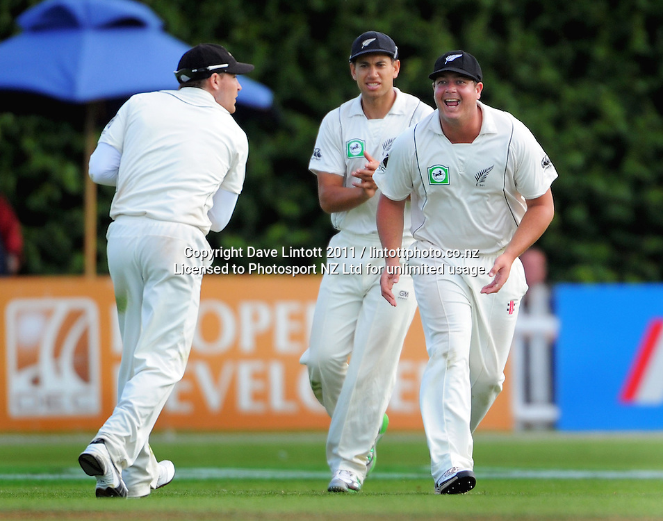 Jesse Ryder (right) and Ross Taylor congratulate Brendan McCullum for catching Umar Gul off Chris Martin. cricket test match - New Zealand Black Caps v Pakistan, day three at the Basin Reserve, Wellington, New Zealand on Monday, 17 January 2011. Photo: Dave Lintott / photosport.co.nz