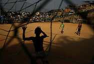 Children play soccer during a soccer classes at the Sao Carlos slum in Rio de Janeiro May 22, 2014. REUTERS/Pilar Olivares (BRAZIL)