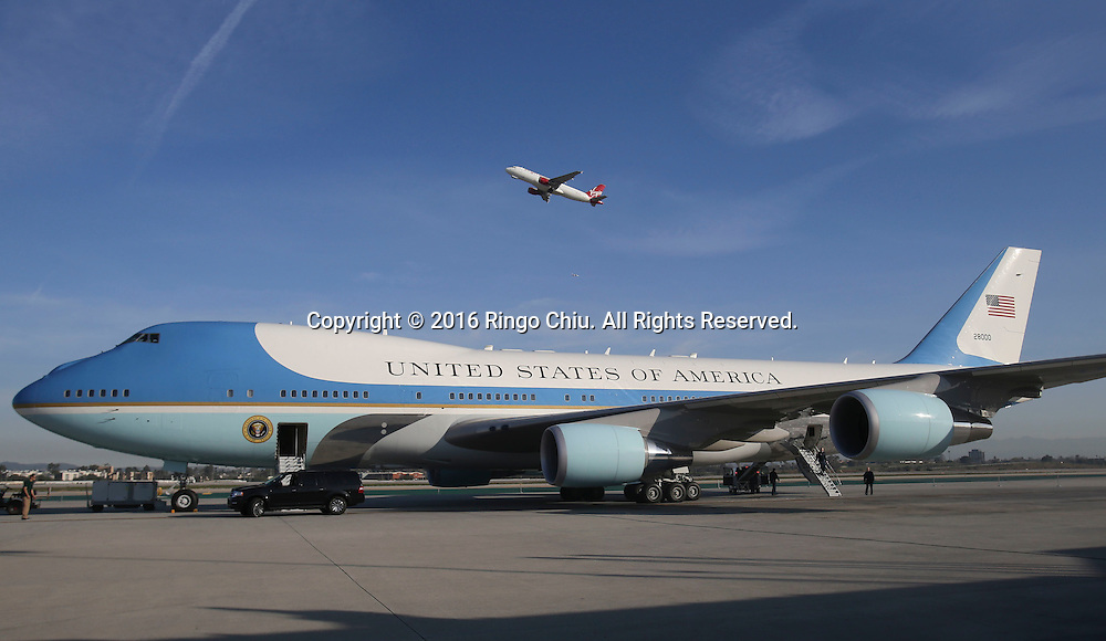 A Virgin Airline aircraft flies past Air Force One sitting on the tarmac before President Barack Obama boarding at Los Angeles International Airport in Los Angeles, Friday, Feb 12, 2016.(Photo by Ringo Chiu/PHOTOFORMULA.com)<br /> <br /> Usage Notes: This content is intended for editorial use only. For other uses, additional clearances may be required.