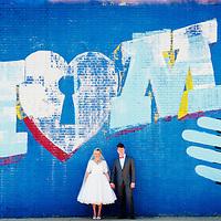 Alison and Matt pose for a wedding portrait in Chicago's Logan Square.