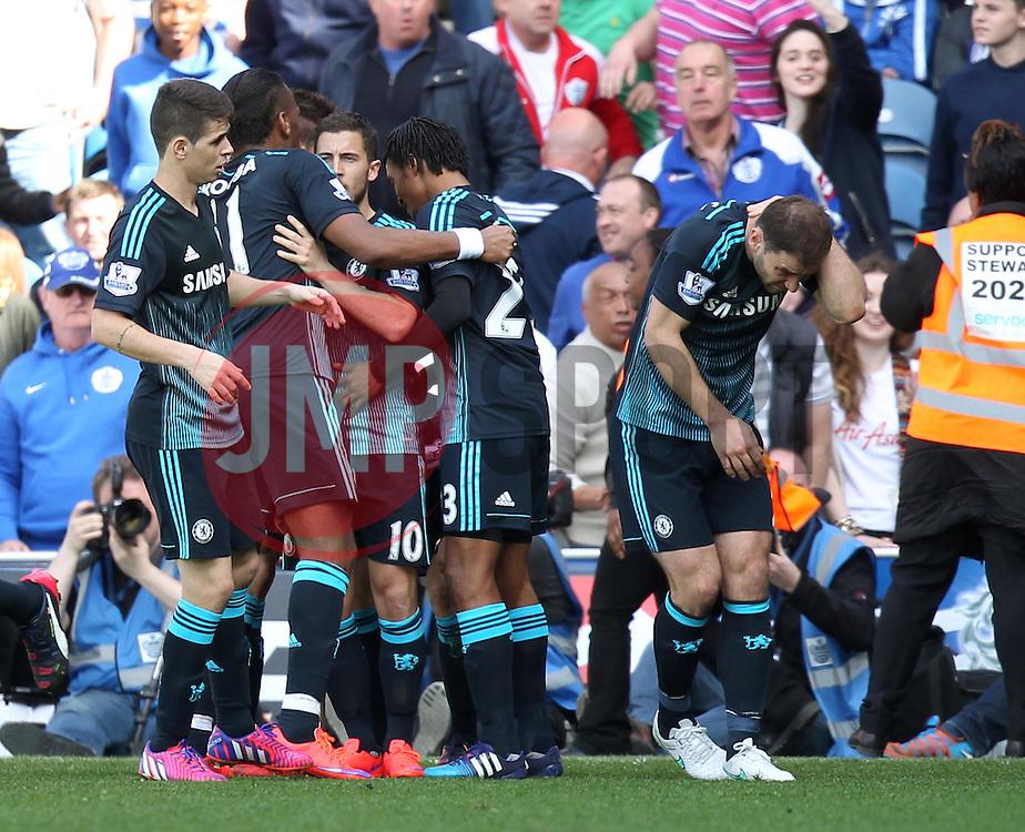 Chelsea's Branislav Ivanovic is struck by a lighter as Chelsea celebrate Chelsea's Cesc Fabregas goal - Photo mandatory by-line: Robbie Stephenson/JMP - Mobile: 07966 386802 - 12/04/2015 - SPORT - Football - London - Loftus Road - Queens Park Rangers v Chelsea - Barclays Premier League
