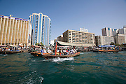 Dubai Creek. Abras (water taxis) in front of Deira skyline.