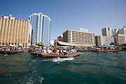 Dubai Creek. Abras (water taxis) in front of Deira skyline.