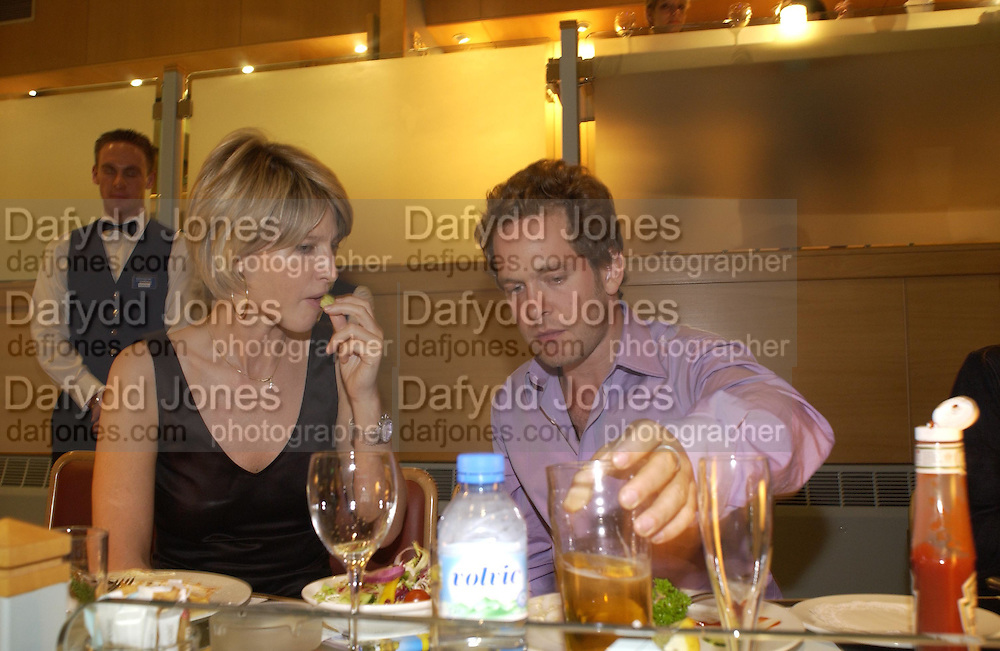 Nicola Fornby and Tom Hollander. Trip to the Walthamstow dog Race track. A.A. Gill, Tim Jeffreys, Nicola  Fornby and a Rolls royce. © Copyright Photograph by Dafydd Jones 66 Stockwell Park Rd. London SW9 0DA Tel 020 7733 0108 www.dafjones.com