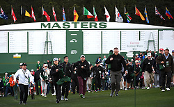 Patrons walk quickly toward the first tee box for the ceremonial opening tee shots by Jack Nicklaus and Gary Player to start The Masters tournament at Augusta National Golf Club on Thursday, April 6, 2016 in Augusta, Ga. The ceremony also honored Arnold Palmer, who passed away in September 2016. (Photo by Jeff Siner/Charlotte Observer/TNS)  *** Please Use Credit from Credit Field ***