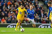 Scott Arfield (#37) of Rangers FC jumps in a tackle with Jesus Corona (#17) of FC Porto during the Group G Europa League match between Rangers FC and FC Porto at Ibrox Stadium, Glasgow, Scotland on 7 November 2019.
