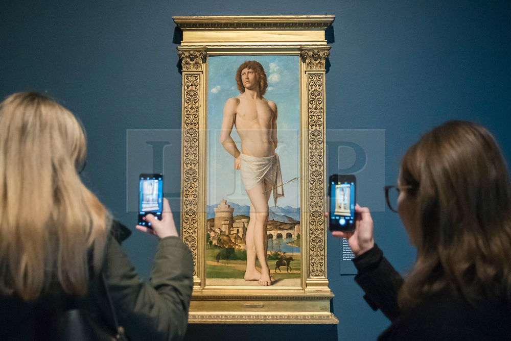 "© Licensed to London News Pictures. 28/02/2019. LONDON, UK. Visitors view ""Saint Sebastian"" c1500-02 by Cima da Conegliano. Preview of ""The Renaissance Nude"", an exhibition at the Royal Academy of Arts in Piccadilly of 90 works examining the emergence of the nude in European art.  Works by artists including Leonardo da Vinci to Michelangelo are on display in the Sackler Galleries 3 March to 2 June 2019.  Photo credit: Stephen Chung/LNP"
