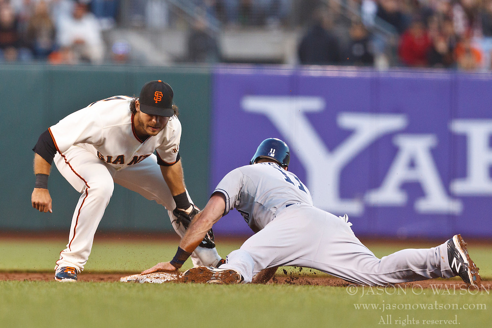 SAN FRANCISCO, CA - JULY 23: Brandon Crawford #35 of the San Francisco Giants tags out Logan Forsythe #11 of the San Diego Padres on an attempted steal of second base during the third inning at AT&T Park on July 23, 2012 in San Francisco, California. The San Francisco Giants defeated the San Diego Padres 7-1. (Photo by Jason O. Watson/Getty Images) *** Local Caption *** Brandon Crawford; Logan Forsythe