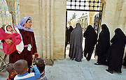 Arabic mother with children and turkish women attend the Friday mass at the great Mosque in Balikligöl (Pool of Sacred Fish )