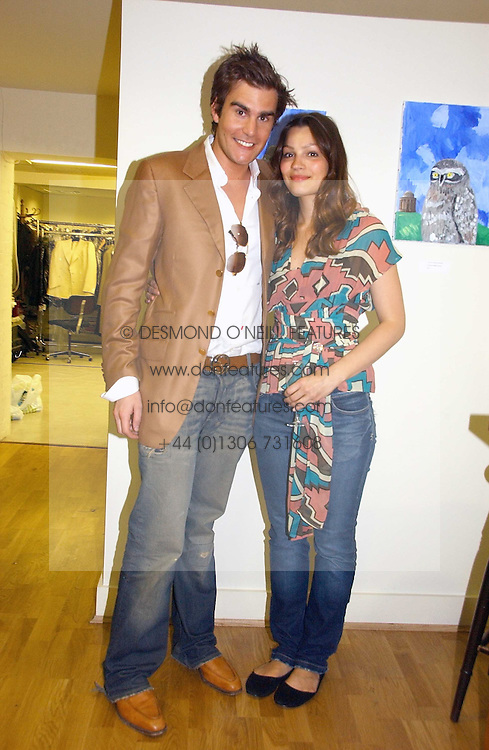 OSCAR HUMPHRIES and SARA PHILIPPIDIS at an exhibition of art by Oscar Humphries entitles 'Post-Nuclear Family' held at Nutters, Lower Ground, 12 Savile Row, London on 8th June 2006.<br /><br />NON EXCLUSIVE - WORLD RIGHTS