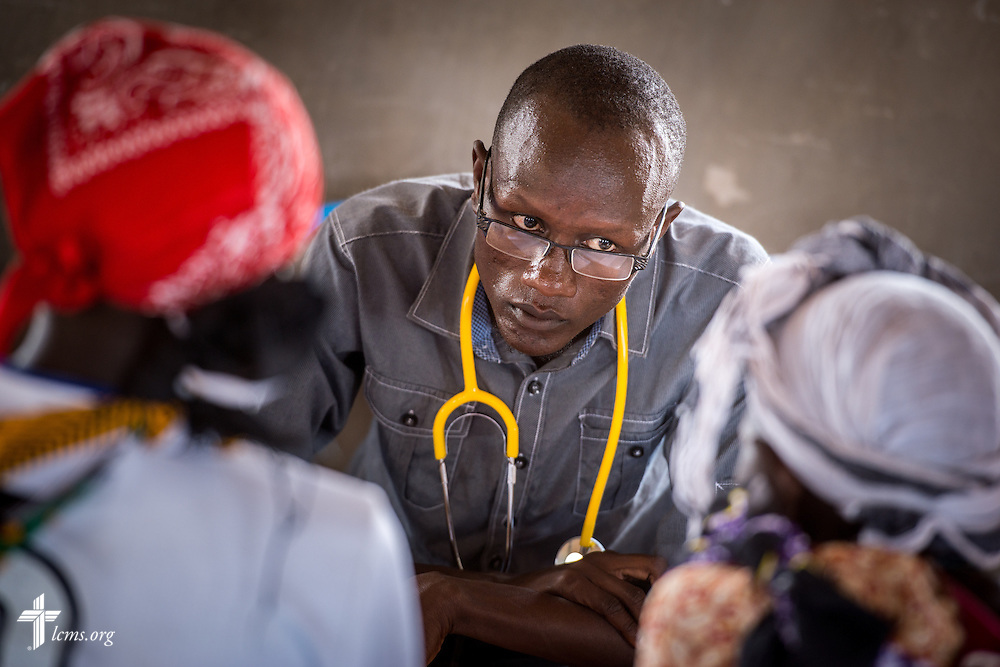 A Kenyan doctor works with patients during the LCMS Mercy Medical Team clinic on Monday, June 20, 2016, in Nataparkakono, a village in Turkana, Kenya.  LCMS Communications/Erik M. Lunsford