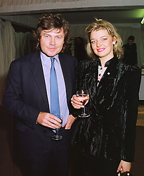 MR RUPERT ALLASON and MISS JANE BURGESS at an exhibition in London on 6th November 1997.MDB 14