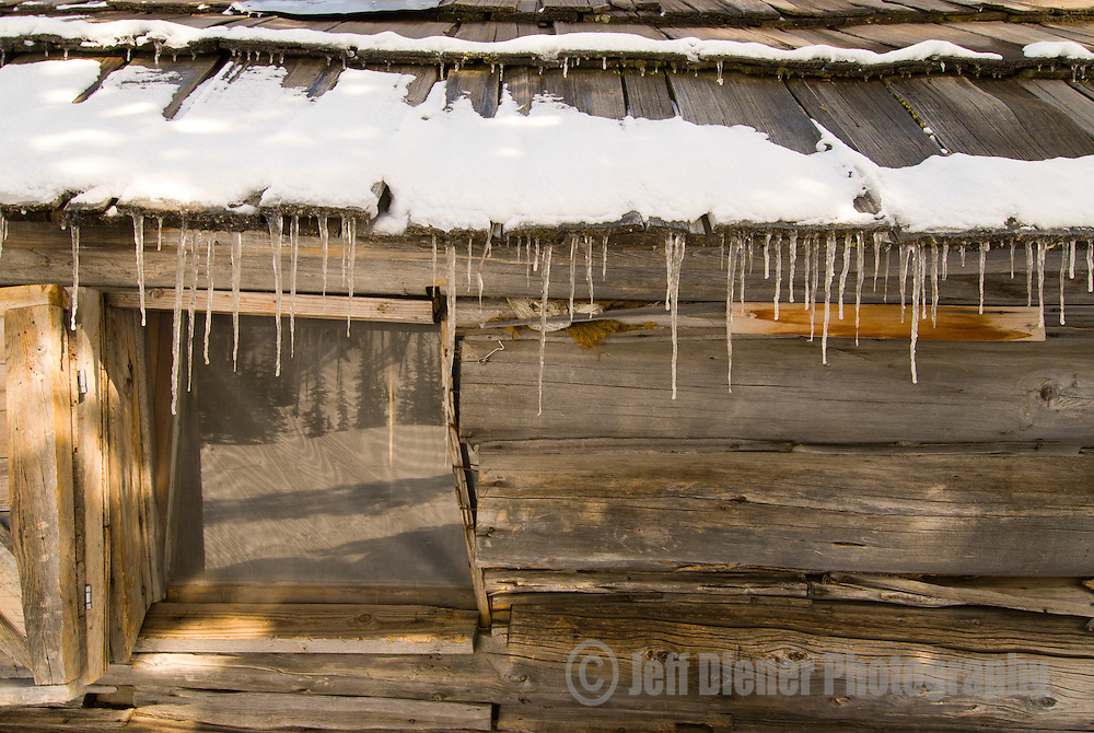Icicles and roofline at the historic Aneroid Lake Cabins.  Wallowa Mountains, Eagle Cap Wilderness Area, Oregon.