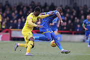 Tom Elliott of AFC Wimbledon and Chey Dunkley of Oxford United FC tussle during the Sky Bet League 2 match between AFC Wimbledon and Oxford United at the Cherry Red Records Stadium, Kingston, England on 27 February 2016. Photo by Stuart Butcher.