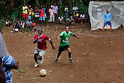 A soccer game is being playing near the village of Treinidade Lamus, near the city of Sao Tome, on the island of Sao Tome, Sao Tome and Principe, (STP) a former Portuguese colony in the Gulf of Guinea, West Africa.
