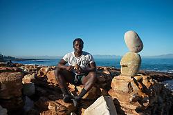 Sipho Njengezi balances rocks in Kalk Bay, Cape Town, on Thursday afternoon, July 17, 2020. PHOTO: EVA-LOTTA JANSSON