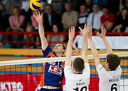 Andrej Flajs of ACH vs Boris Brus and Jan Brulec of Calcit during volleyball match between Calcit Volleyball and ACH Volley in 4th Final Round of Radenska Classic League 2012/13 on April 16, 2013 in Arena Kamnik, Slovenia. (Photo By Vid Ponikvar / Sportida)