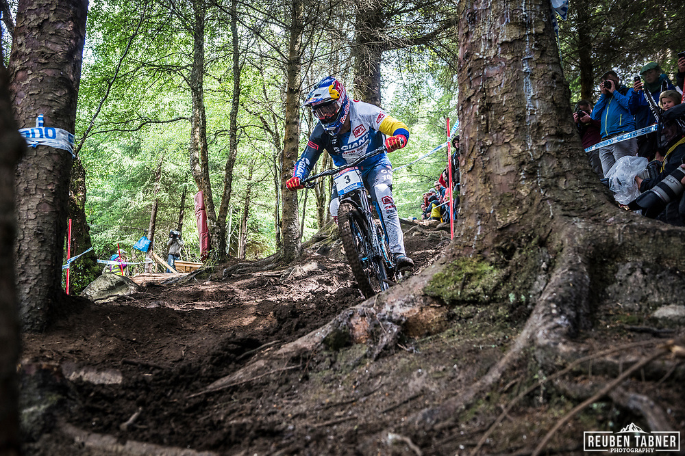 Marcelo Gutierrez Villegas chops through the trees during his Qualifying Run at the UCI Mountain Bike World Cup in Fort William.