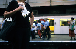 UK ENGLAND LONDON AUG99 - A woman waits for a train at Earl's Court station.  ..The London Underground is a rapid transit system serving a large part of Greater London and neighbouring areas of Essex, Hertfordshire and Buckinghamshire in the UK. The Underground has 270 stations and about 400 km of track, making it the longest metro system in the world by route length; it also has one of the highest number of stations and transports over three million passengers daily...jre/Photo by Jiri Rezac..© Jiri Rezac 1998
