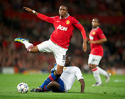 27.09.2011, Old Trafford, London, ENG, UEFA CL, Gruppe C, Manchester United (ENG) vs FC Basel (SUI), im Bild Manchester United's Ashley Young in action against FC Basel 1893's Cabral // during the UEFA Champions League game, group C, Manchester United (ENG) vs FC Basel (SUI) at Old Trafford stadium in London, United Kingdom on 2011/09/27. EXPA Pictures © 2011, PhotoCredit: EXPA/ Propaganda Photo/ David Rawcliff +++++ ATTENTION - OUT OF ENGLAND/GBR+++++