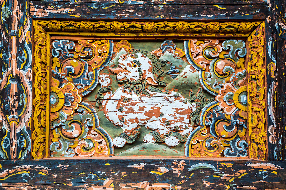 Wood carving in a Buddhist temple, Bhutan