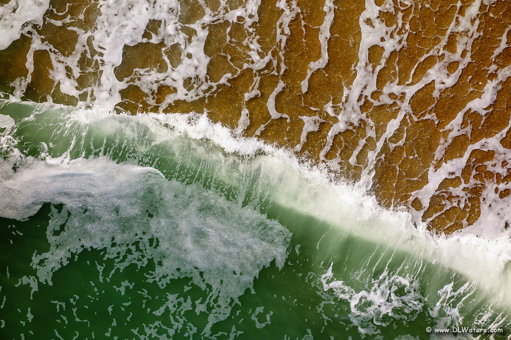 Aerial photograph of green surf on the Outer Banks North Carolina.
