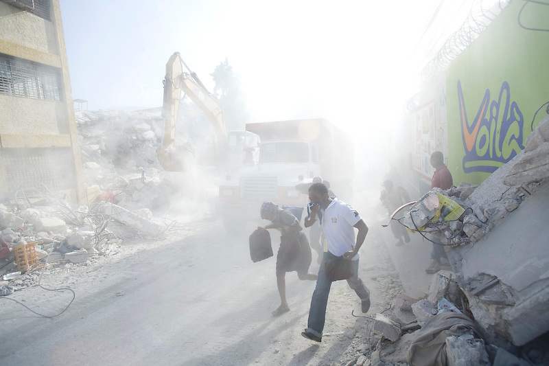 A road is cleared of rubble. In spite of the destruction, Haitians are beginning to rebuild their lives. Port Au Prince, Haiti. Photo by Ben Depp.1/20/2010.