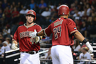 PHOENIX, AZ - JULY 06:  Paul Goldschmidt #44 of the Arizona Diamondbacks high fives Yasmany Tomas #24 after scoring during the first inning against the San Diego Padres at Chase Field on July 6, 2016 in Phoenix, Arizona.  (Photo by Jennifer Stewart/Getty Images)