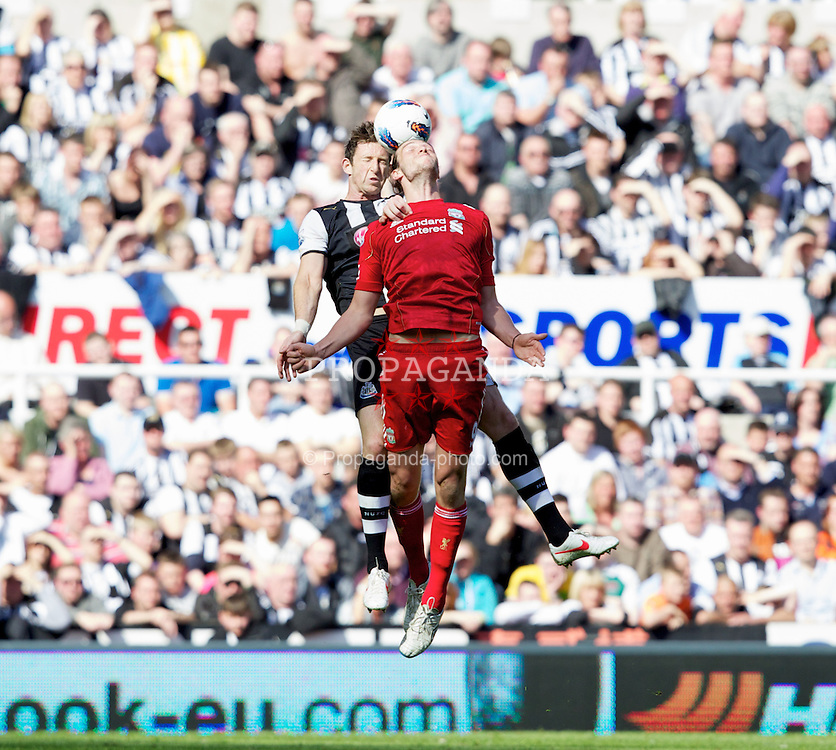 NEWCASTLE-UPON-TYNE, ENGLAND - Sunday, April 1, 2012: Liverpool's Andy Carroll in action against Newcastle United's Mike Williamson during the Premiership match at St James' Park. (Pic by Vegard Grott/Propaganda)