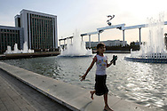 In Tashkent city centre, a girl is running