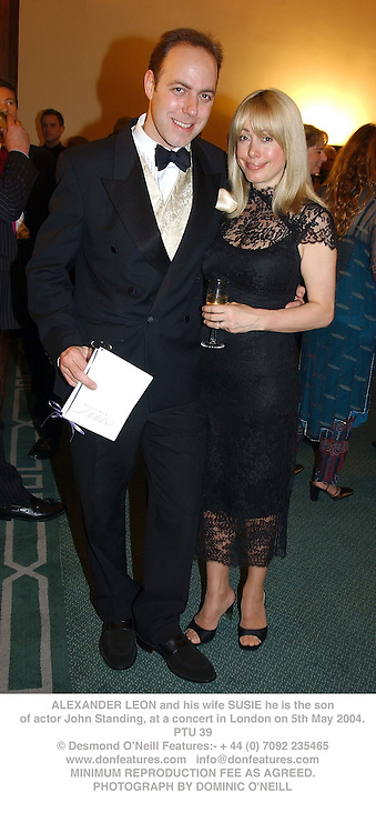 ALEXANDER LEON and his wife SUSIE he is the son of actor John Standing, at a concert in London on 5th May 2004.PTU 39