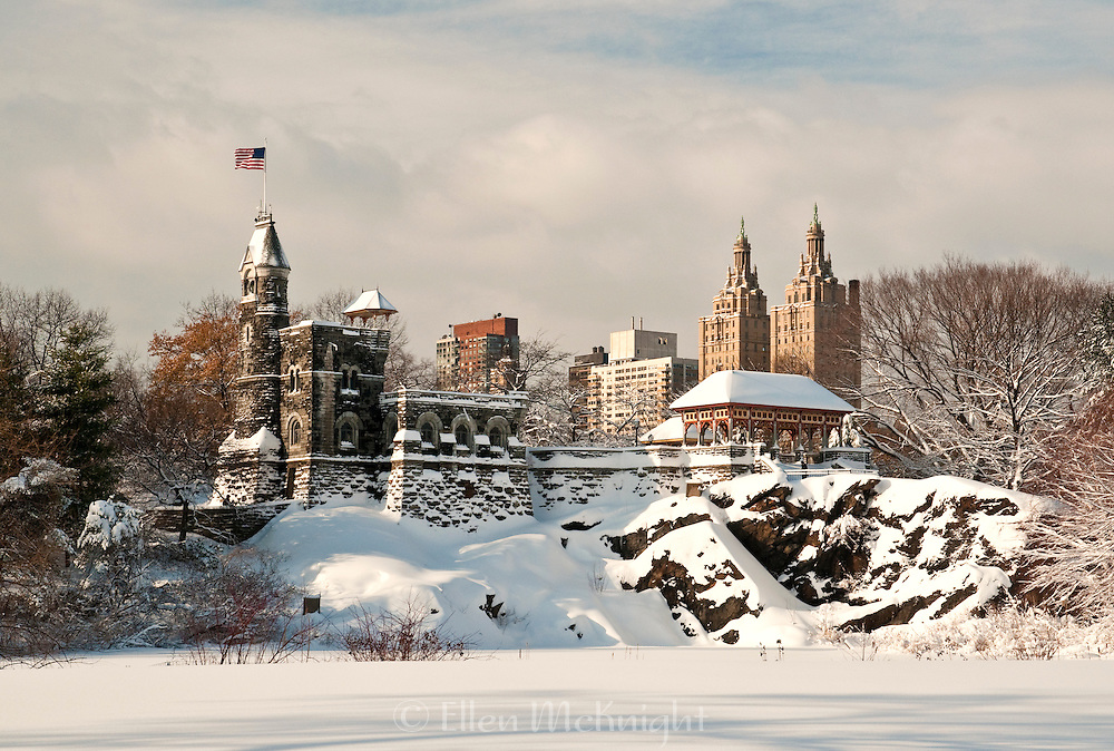 Belvedere Castle in Central Park, New York City after a snowstorm. The twin towers of the San Remo building are in the background.