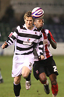 Photo: Pete Lorence/Sportsbeat Images.<br /> Lincoln City v Darlington. Coca Cola League 2. 22/12/2007.<br /> Neil Austin (l) and Lenell John-Lewis (r) battle for the ball.