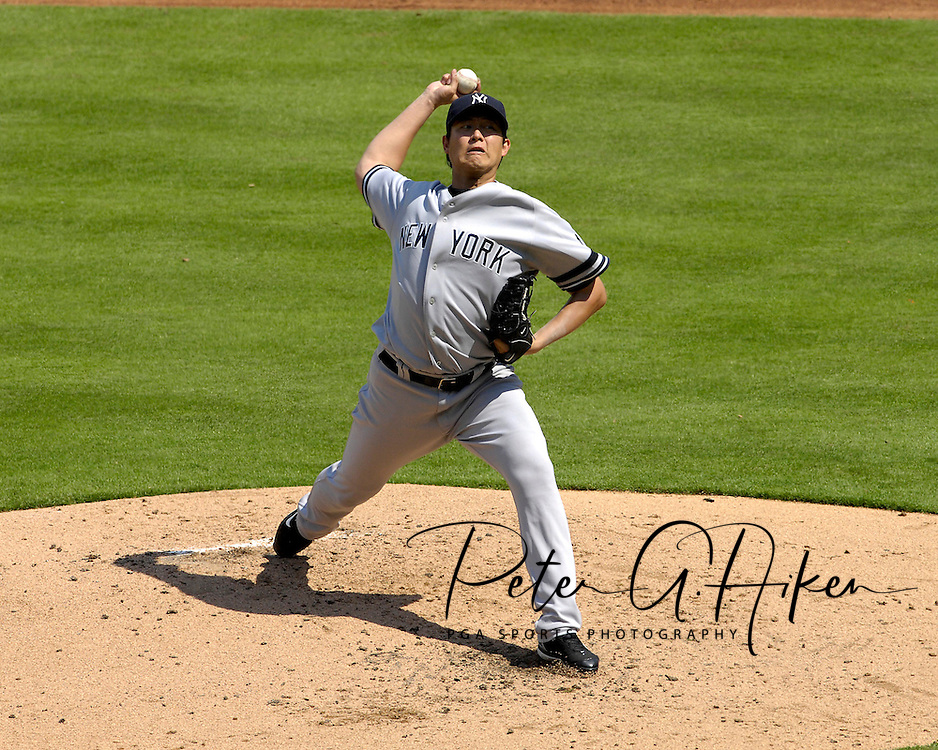 September 9, 2007 - Kansas City, MO..New York Yankees pitcher Chien-Ming Wang delivers a pitch during a game against the Kansas City Royals at Kauffman Stadium in Kansas City, Missouri on September 9, 2007....Photo by Peter G. Aiken/Cal Sport Media